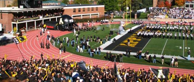Appalachian State football team entering the field house for a football game.