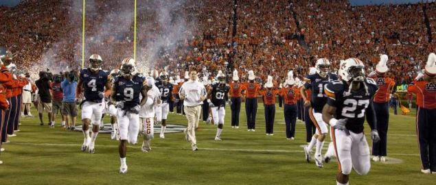 The Auburn Tigers entering home field.