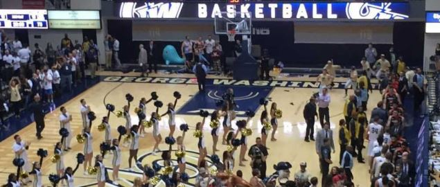 Fans storm the court after George Washington University defeats the University of Virginia