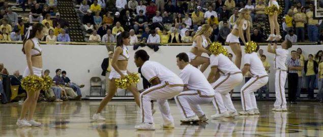 Georgia Tech Yellow Jacket cheerleaders cheering during game against Centenary.