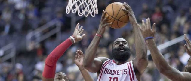 James Harden attacking the basket during a Houston Rockets game versus the Washington Wiza