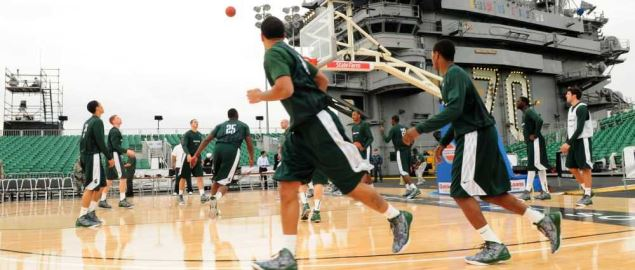 The Michigan State Spartans practice on the flight deck of the Nimitz-class.