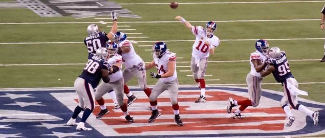 Eli Manning throws the ball for a hail mary.