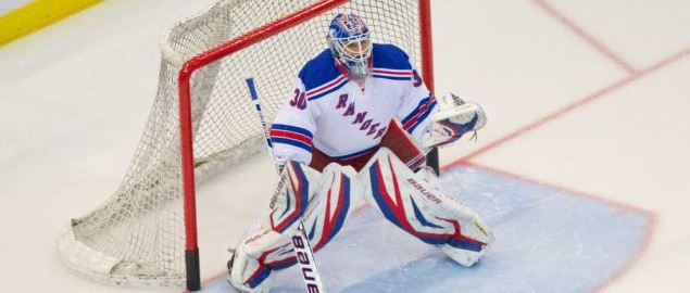 The New York Rangers goalie prepared to defend the goal.