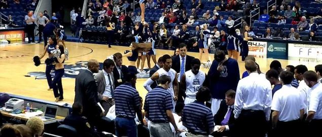 Old Dominion Monarchs huddle during a timeout.