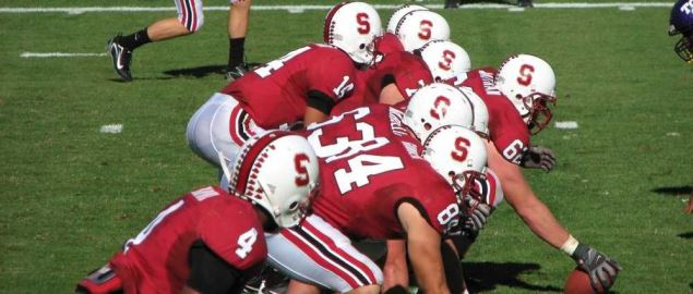 The Stanford Cardinal football team lining up for a play.