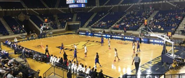 The Navy Midshipmen playing a game at their home court.