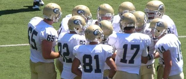 The UC Davis Aggies in a huddle during a road game against the California Golden Bears.