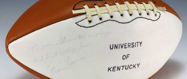 A football signed by the University of Kentucky Wildcats coach, Fran Curci.