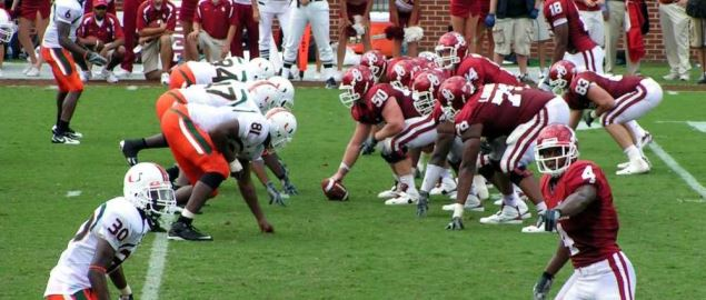 The Oklahoma Sooners are lined up on offense against the defense of the Miami Hurricanes.