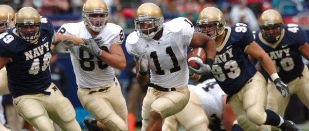 Notre Dame running back races for yardage against the U.S. Naval Academy Midshipmen.