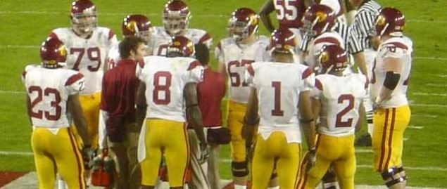 The University of Southern California Trojans football team huddles before a play.