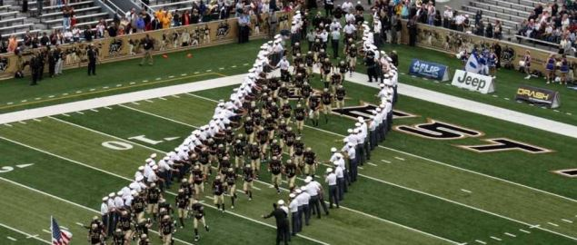 West Point Cadets line the field as the Army Black Knights rush the field.