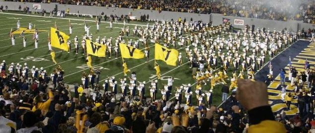 The West Virginia University Mountaineers football team enters Mountaineer Field.